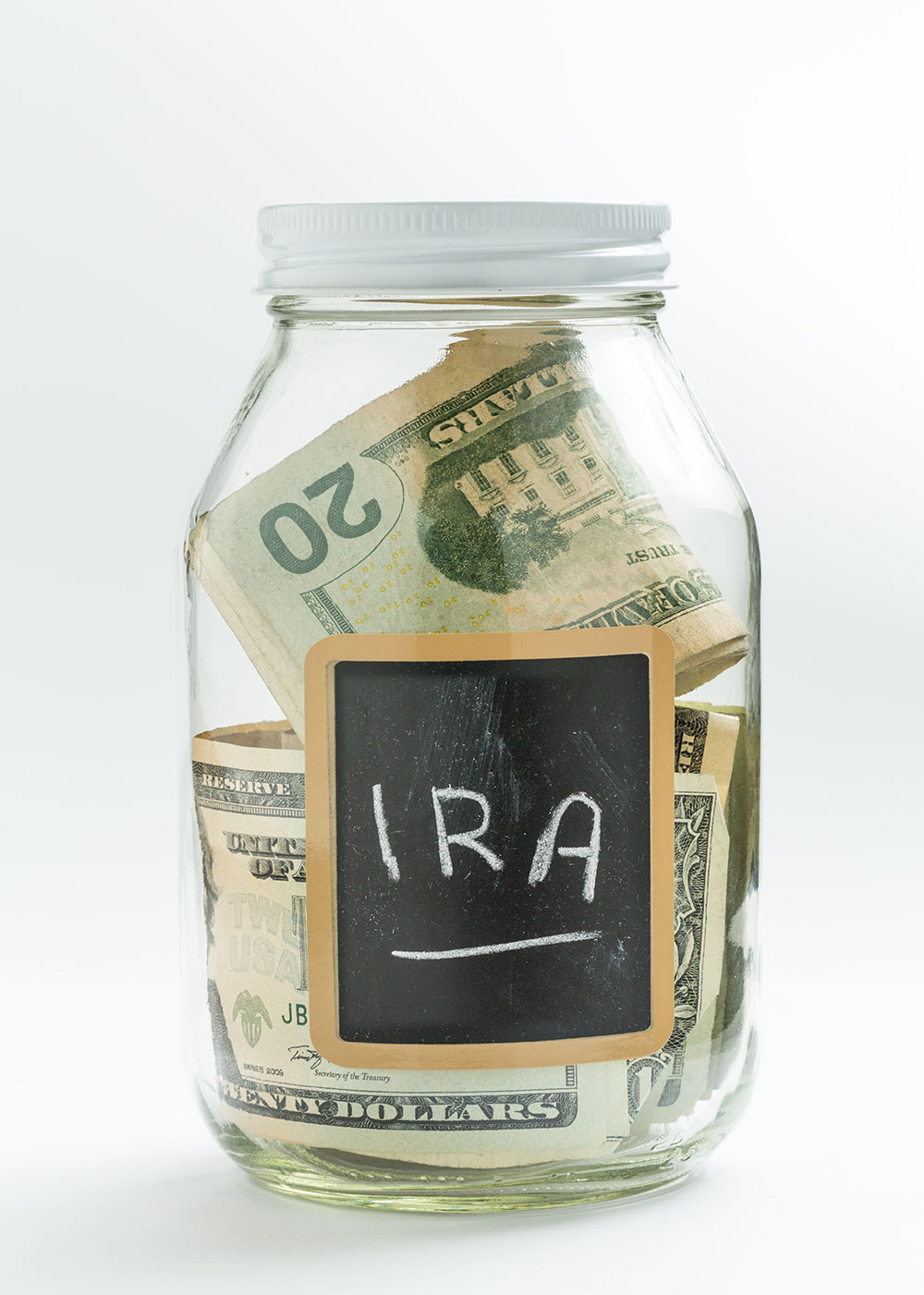 Jar with money in it and a chalkboard label with I.R.A. written on it