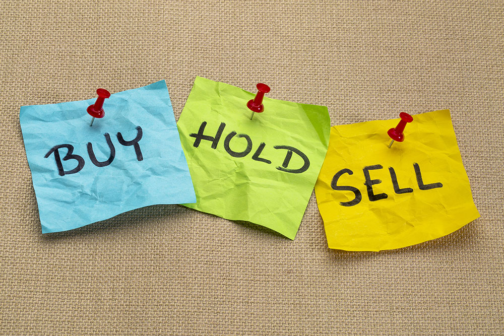sticky notes with Buy, Hold, and Sell written on them