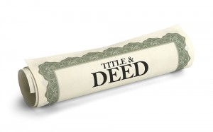Wrapped up contract with the word Title & Deed on it