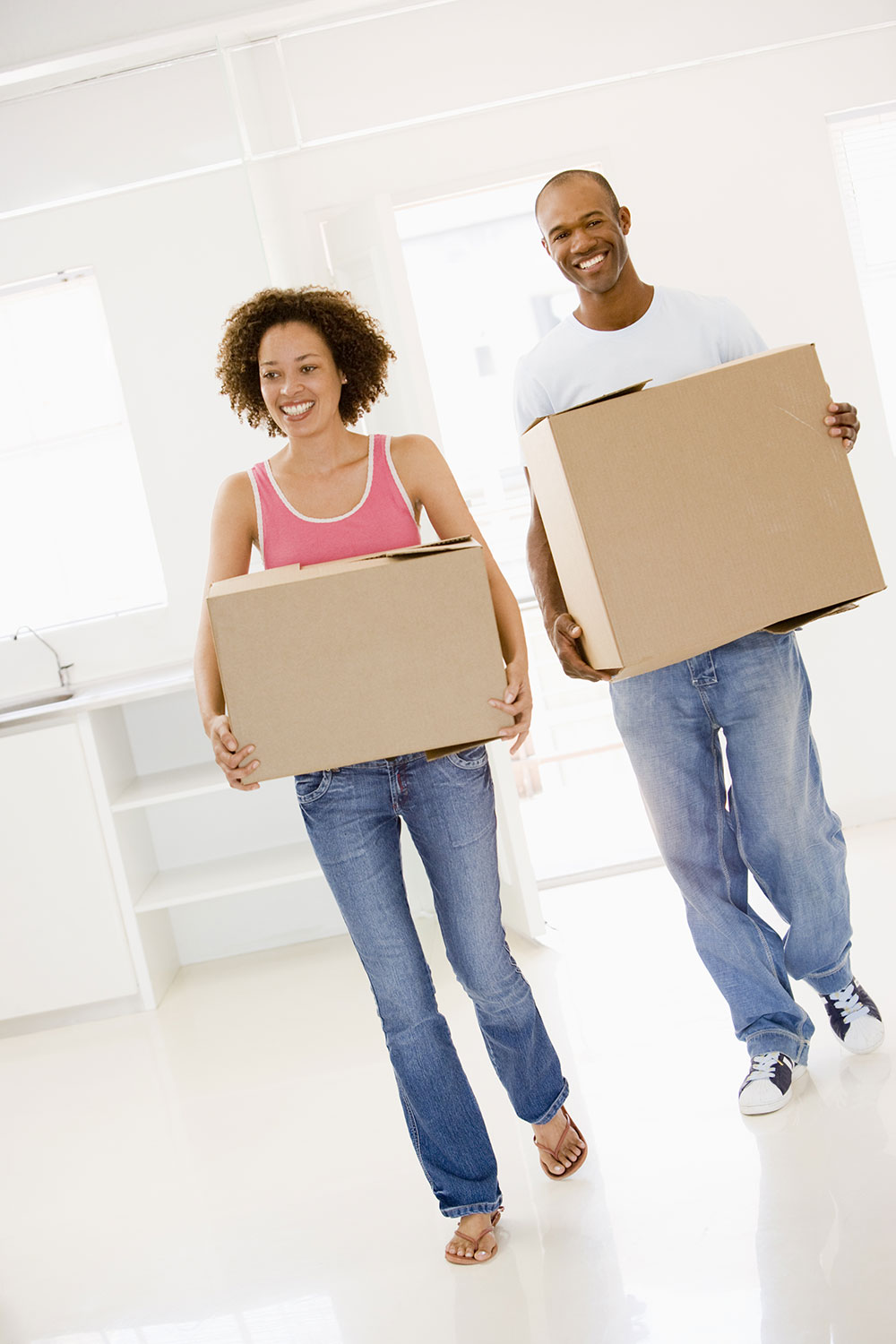 first time home buying couple moving boxes