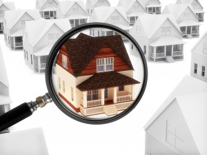 Photo illustration of a house beneath a magnifying glass standing out from the others in the neighborhood